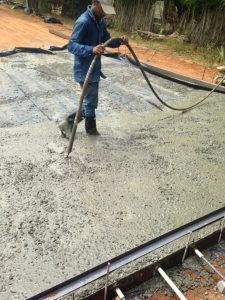 Using Poker vibrator in the concrete to avoid honycomb