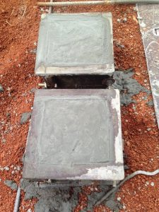 Adding concrete to cube moulds